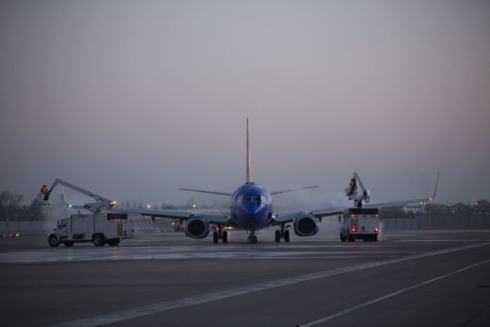 Southwest Airlines Ramp Agents De-Ice Aircraft Prior to Takeoff