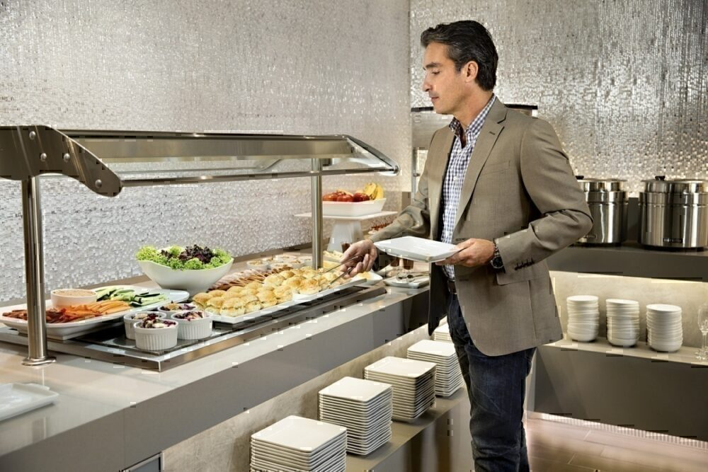 Man at Admirals Club lounge buffet