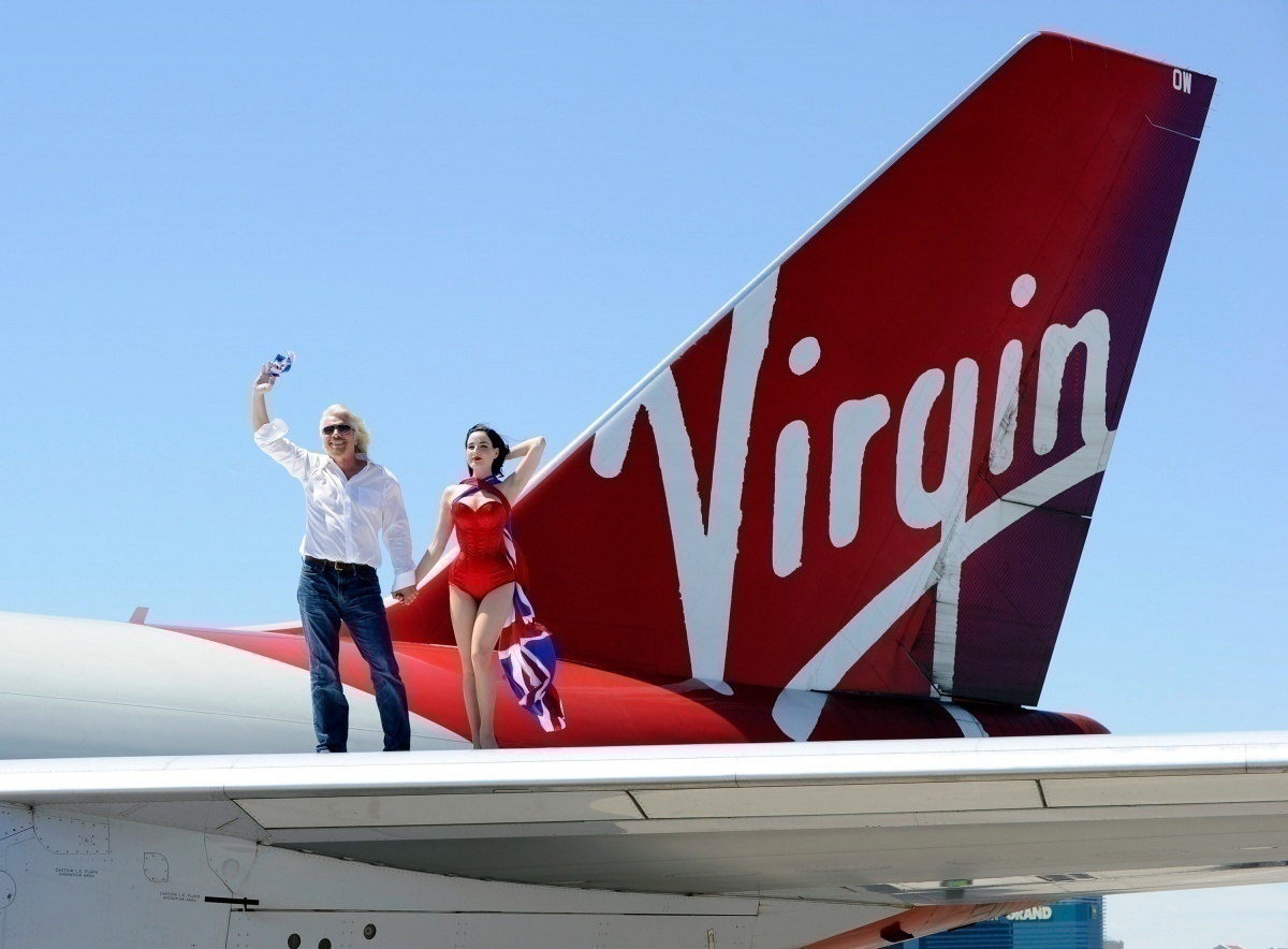 Branson and cabin crew on aircraft wing