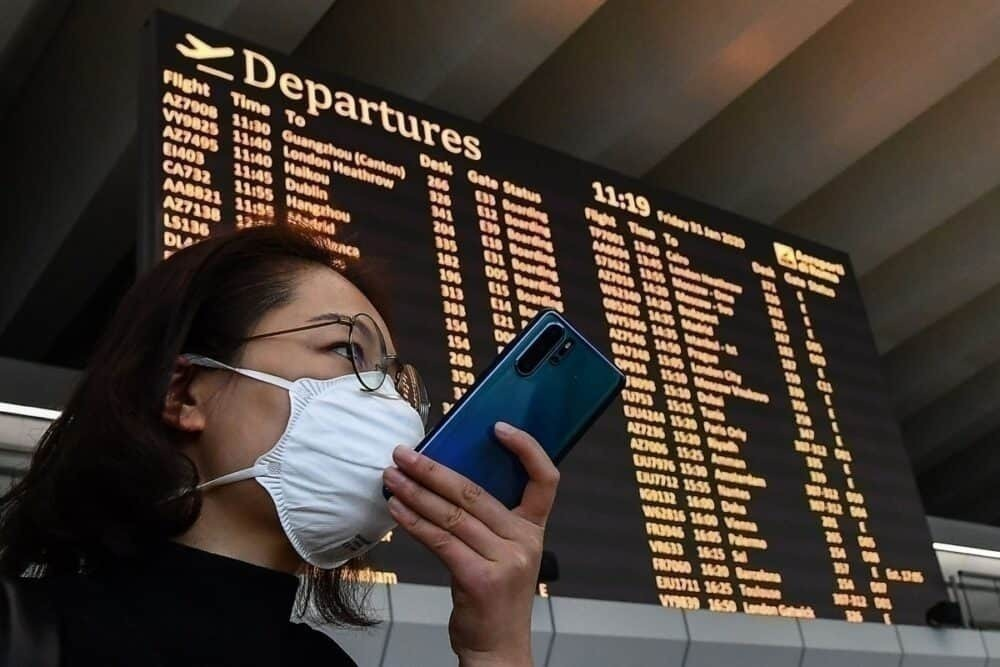 Passenger wearing masks near deaprtures boarding in Rome Airport
