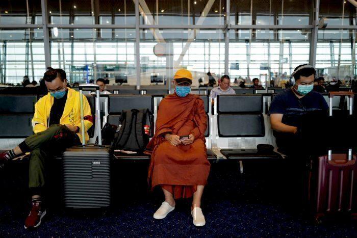 Passengers waiting to board at Hong Kong airport