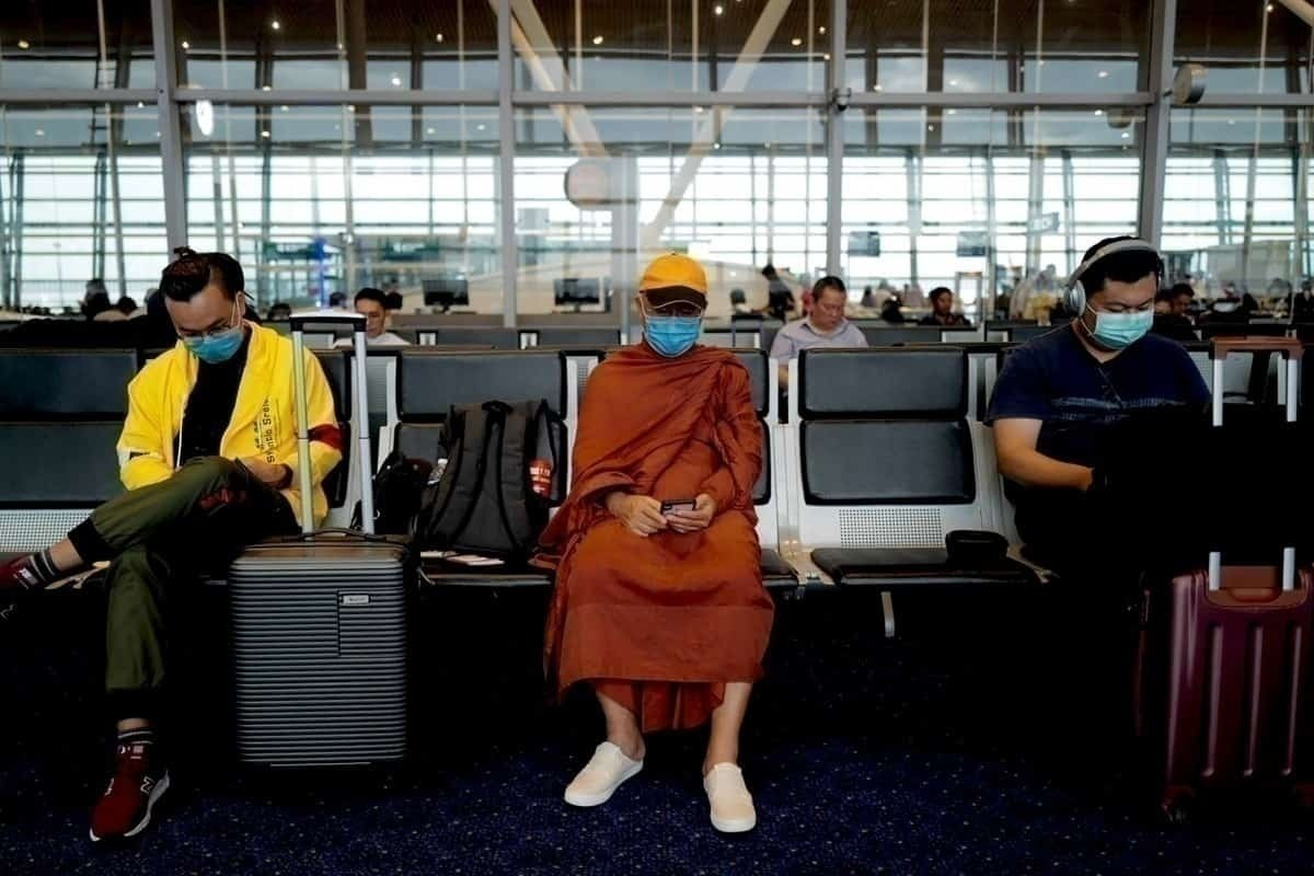 People sit apart with face masks