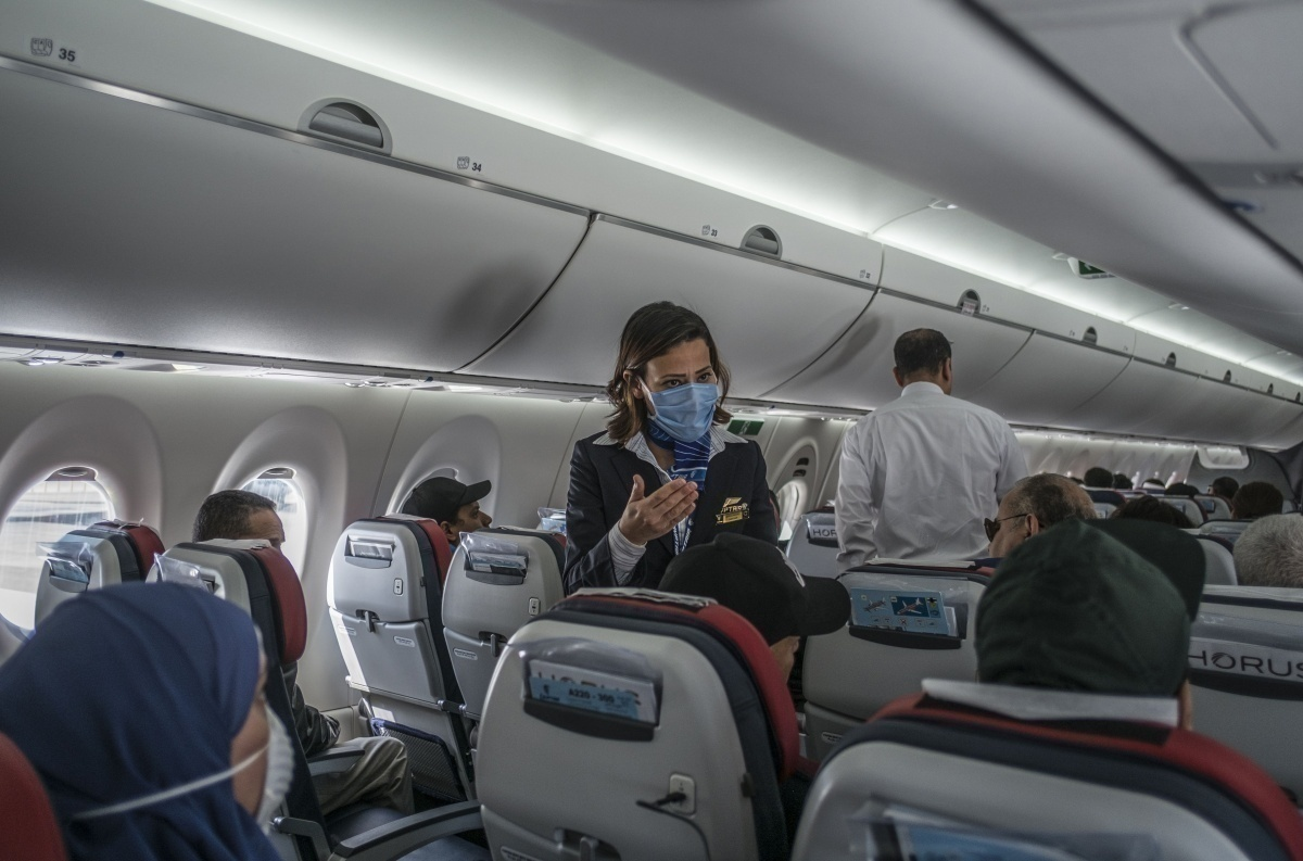 flight attendants see to passengers before taxi