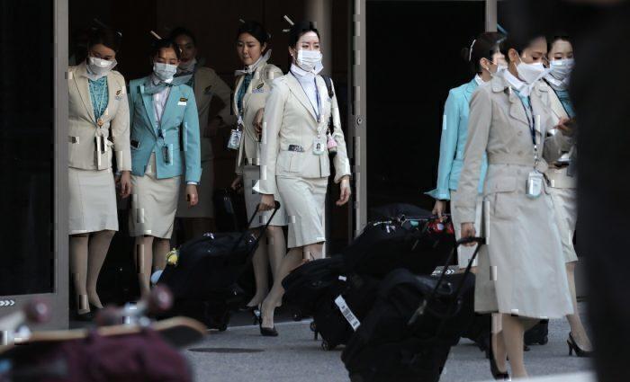 Cabin crew wears protective gear for Korean Air