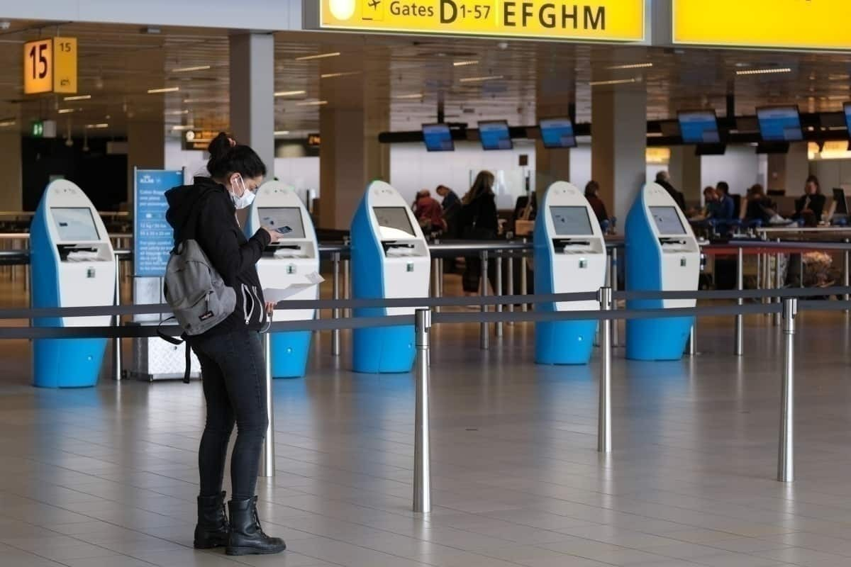 Woman wears mask in Amsterdam Schiphol Airport