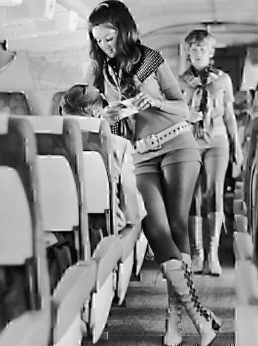 Women cabin crew in short clothing uniform