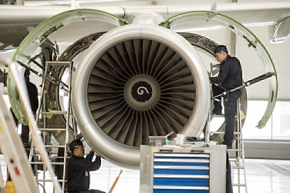 Chinese labourers work at the distribution chain for jet engines as French Prime Minister Manuel Valls visits an Airbus factory in Tianjin