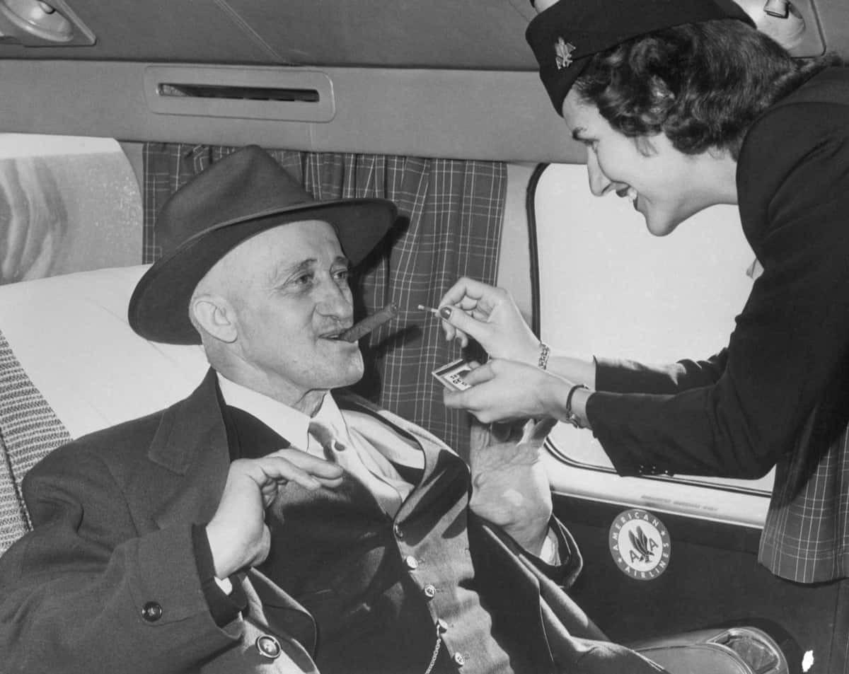 woman cabin crew lights cigar
