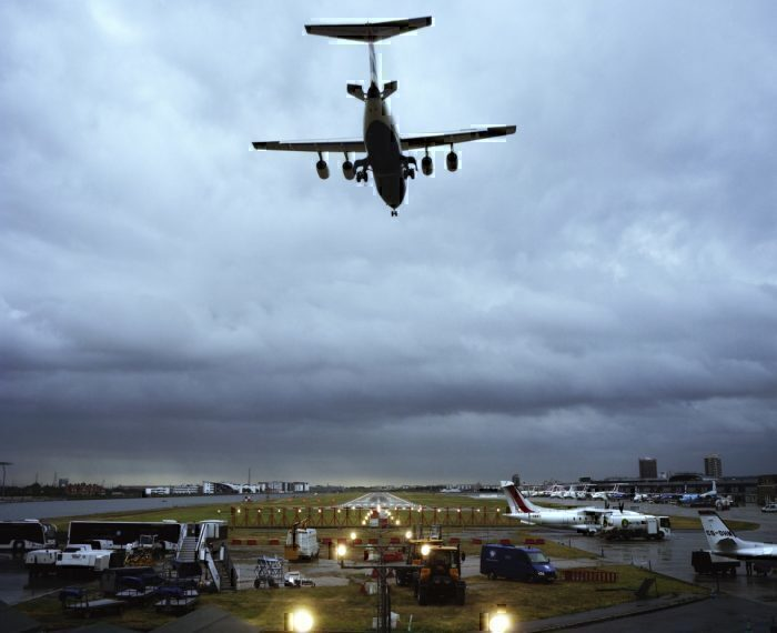 Aircraft flies over London city airport