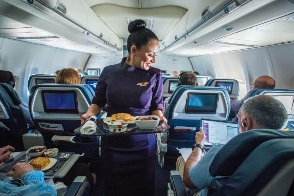 flight attendant serves food