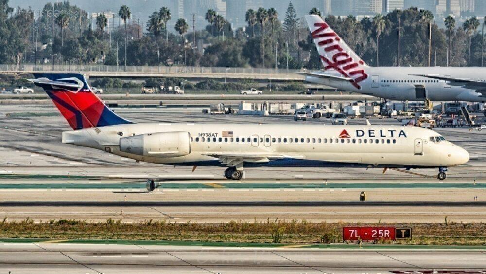 Delta aircraft passing Virgin Atlantic aircraft