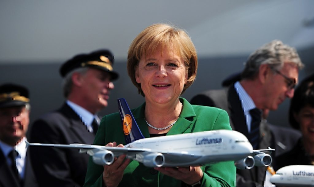 Angela Merkel holds Lufthansa plane model