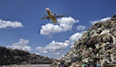 Plane flies over landfill in the Philippenes