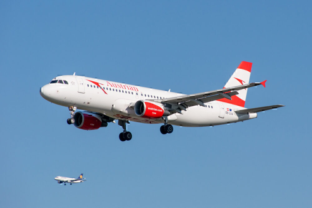 Austrian airlines flies with Lufthansa in the background