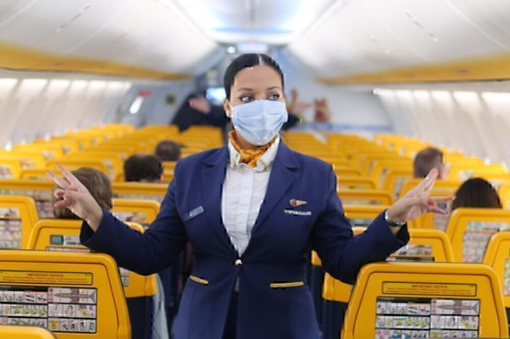 Cabin crew with face mask in ryanair cabin