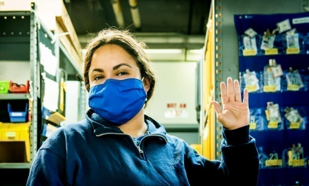 Female United employee wears face mask