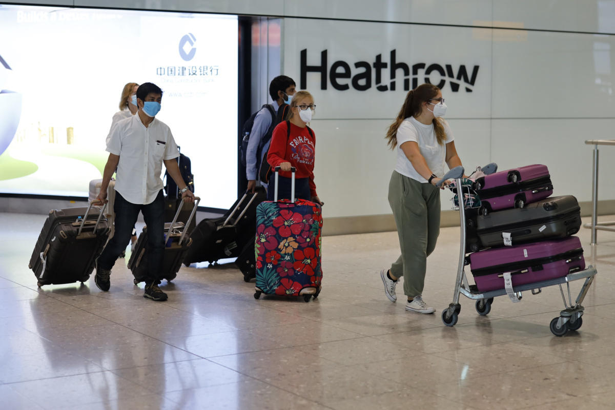 Heathrow Arrivals with masks