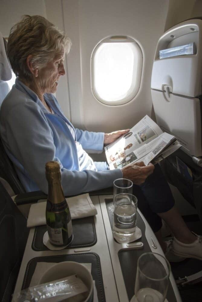 Woman reads inflight magazine