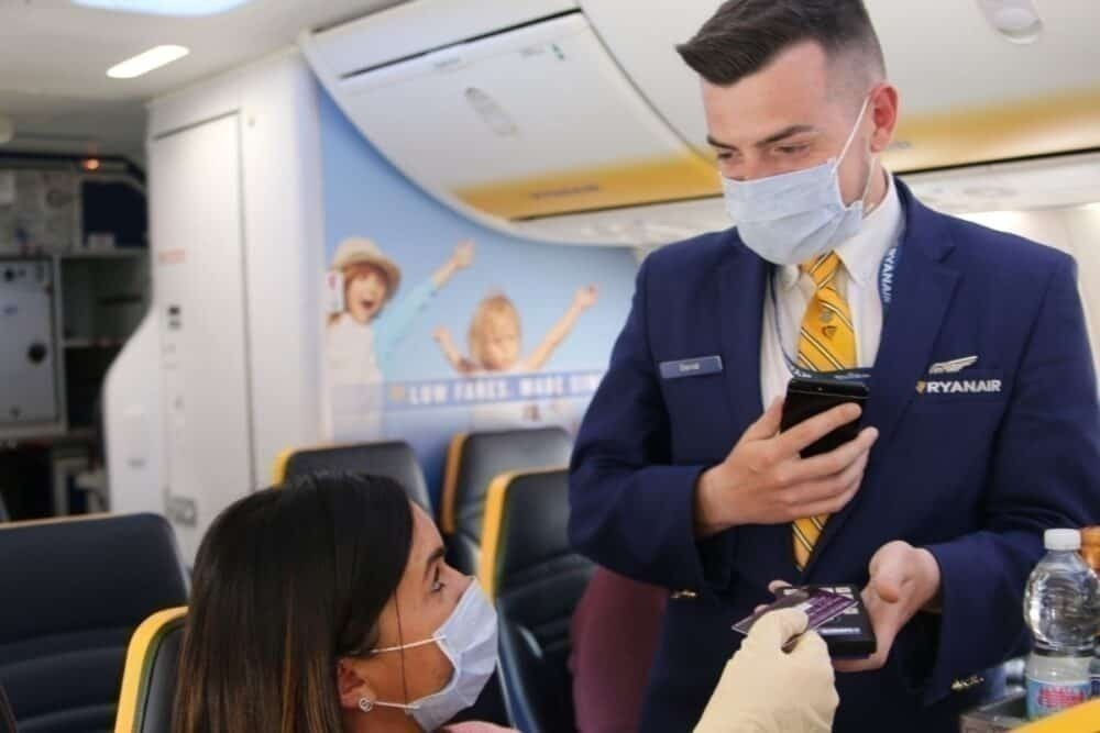 in-flight service, cabin crew with mask, passenger with mask