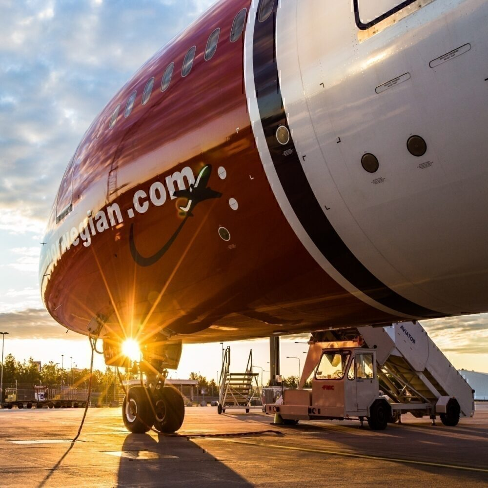Norwegian aircraft with sunset