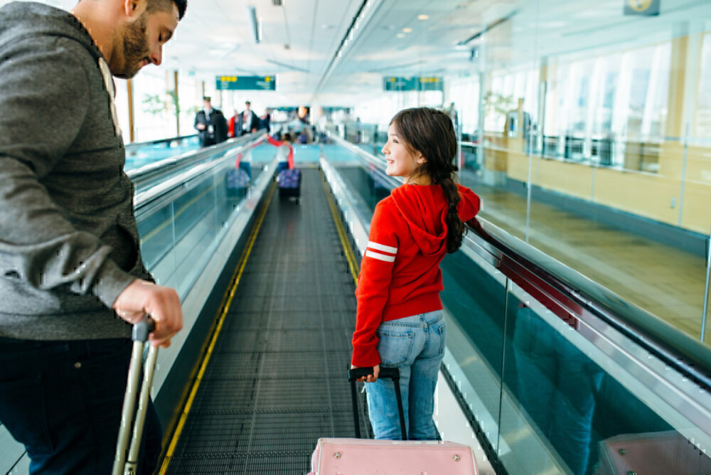 Dad and daughter on conveyor belt