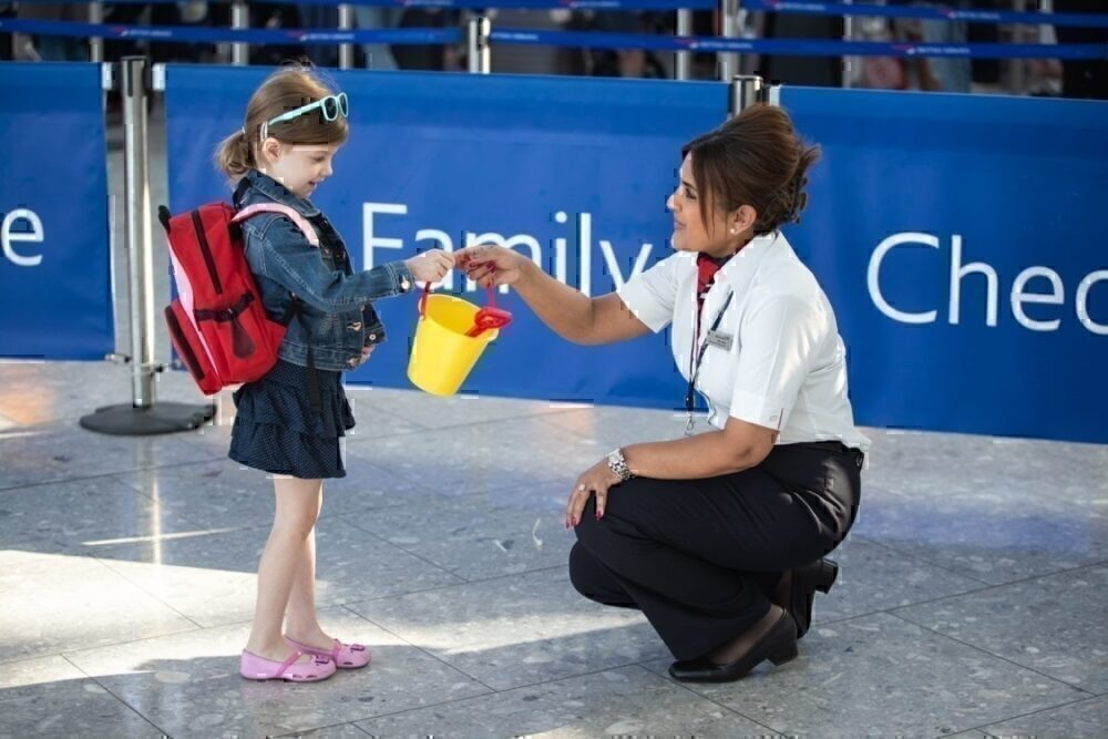Child with bucket with BA staff member