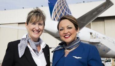 two femal flight attendants near aircraft