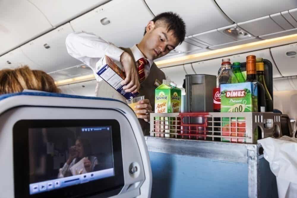 Aeroplane Inflight Cabin Attendent Serving Drinks