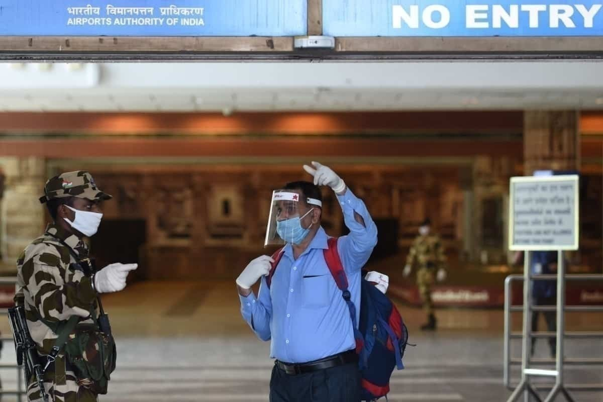 Customers with PPE at India airport