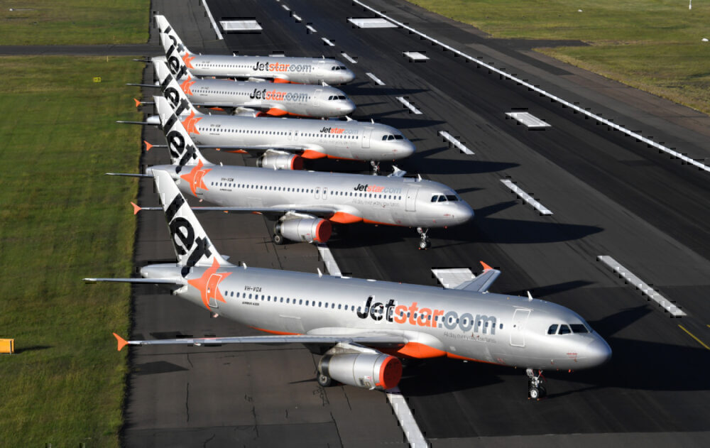 Jetstar Asia aircraft parked on the runway.
