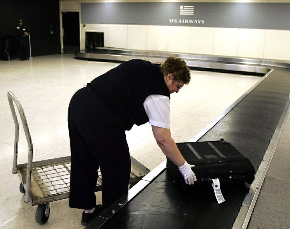 Airport worker collects baggage in Chicago