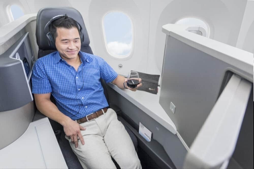 American airlines man enjoys film with wine