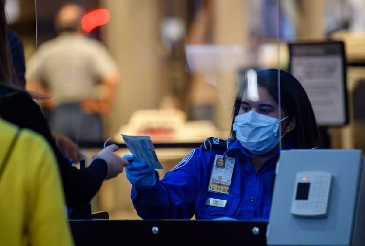 TSA staff, handing tickets