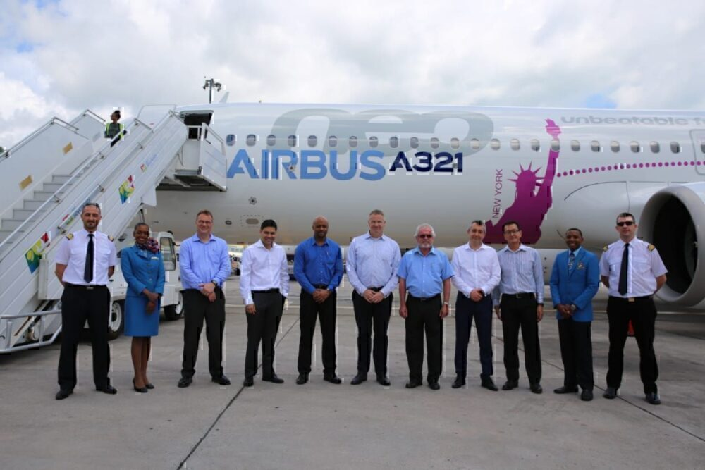 Crew beside A321LR which flew from Mahe to Toulouse