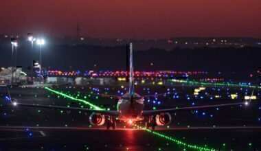 plane landing night time getty images