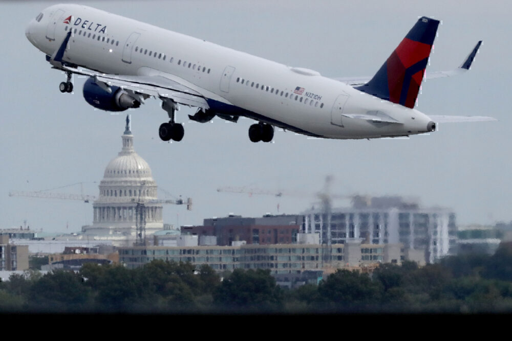 Alaska bans 14 after rowdy behavior on Washington flight