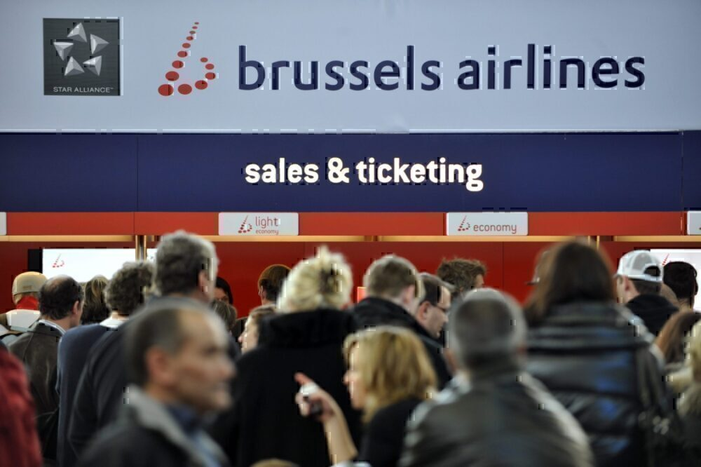 People in line at sales and ticketing queue, Brussels Airlines