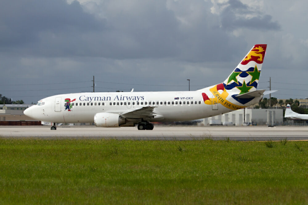 cayman airways changes schedule due to Delta storm
