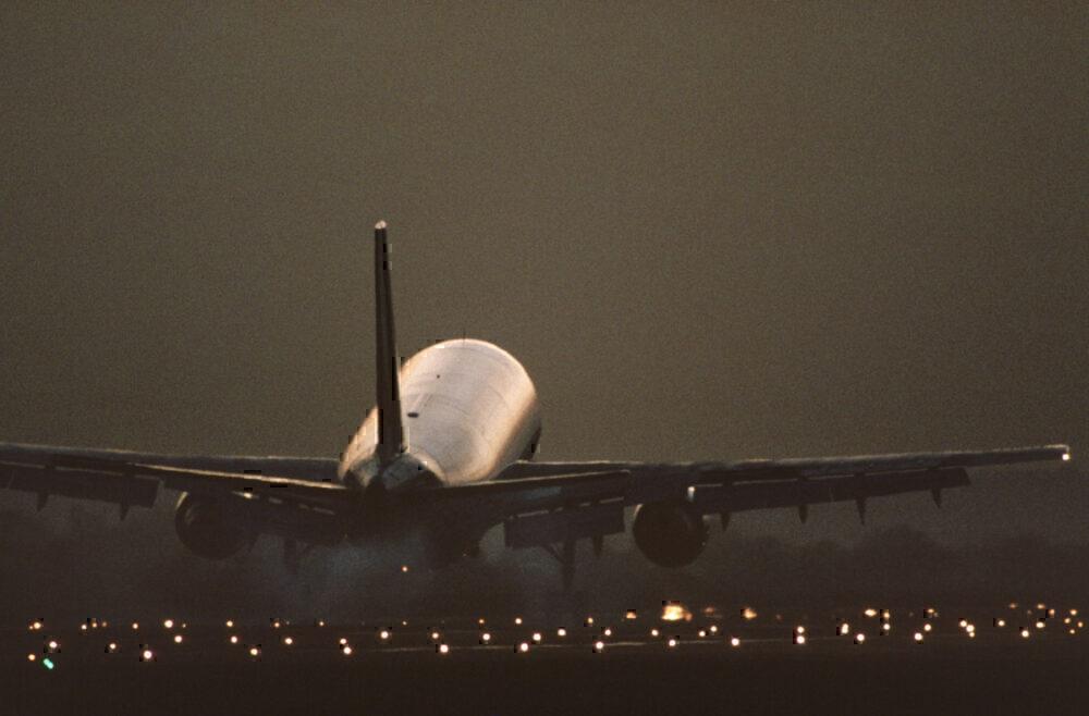 Airbus A300B4 landing at dusk