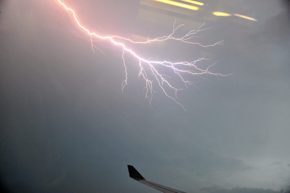 Lightning outside plane window