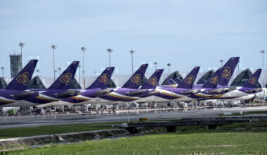 Thai Airways International plane are parked on a runway of