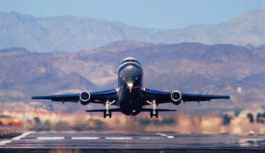 Lockheed L-1011 Tristar taking-off with mountains behind.
