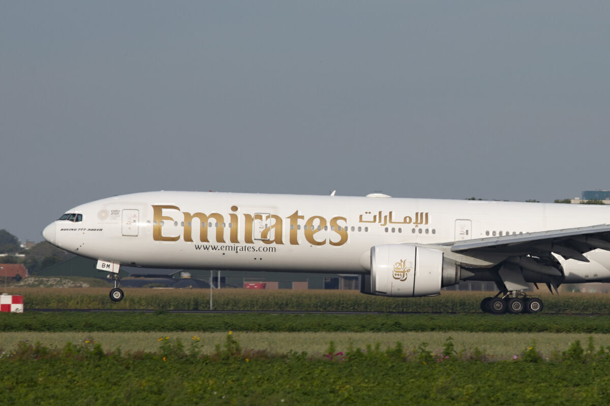 Emirates, Boeing 777-300ER commercial airplane lands at