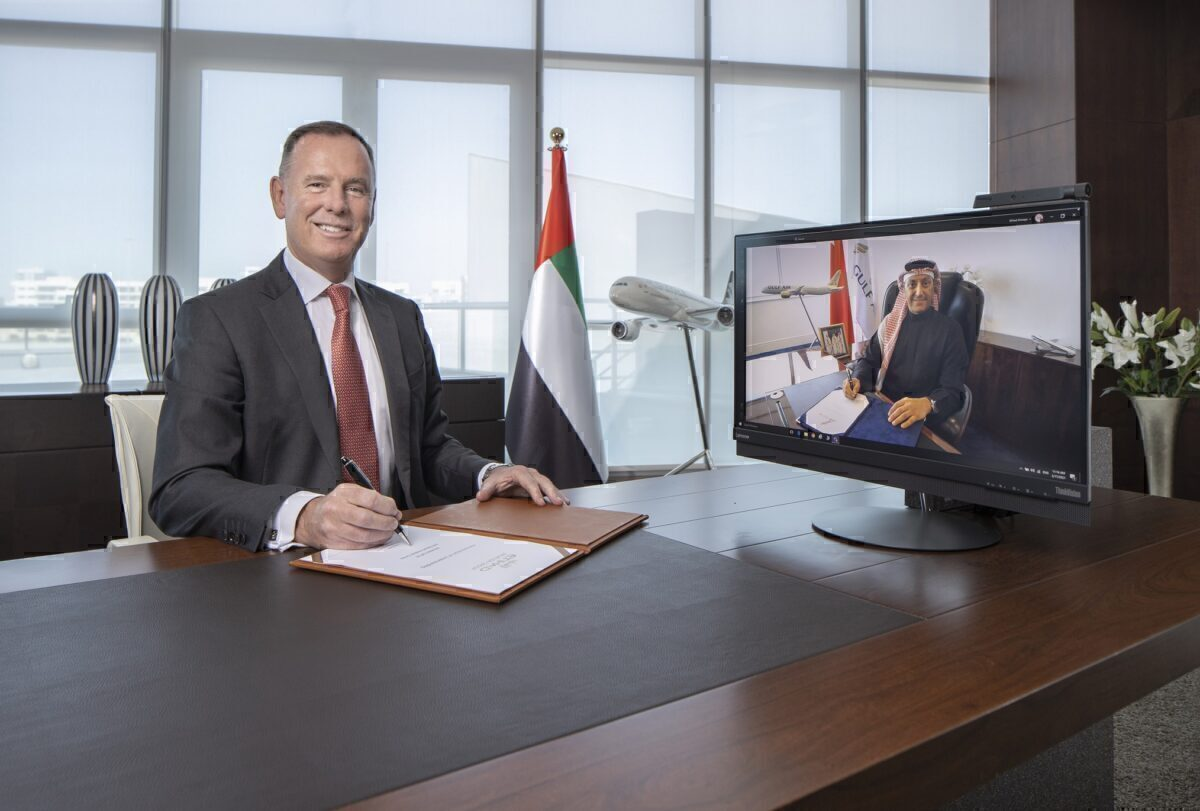 Tony Douglas, Etihad Aviation Group GCEO and Captain Waleed AlAlawi, Gulf Air Acting CEO sign SCAA agreement LR