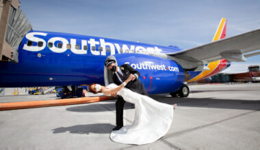 A bride and groom stand outside a Southwest Boeing 737
