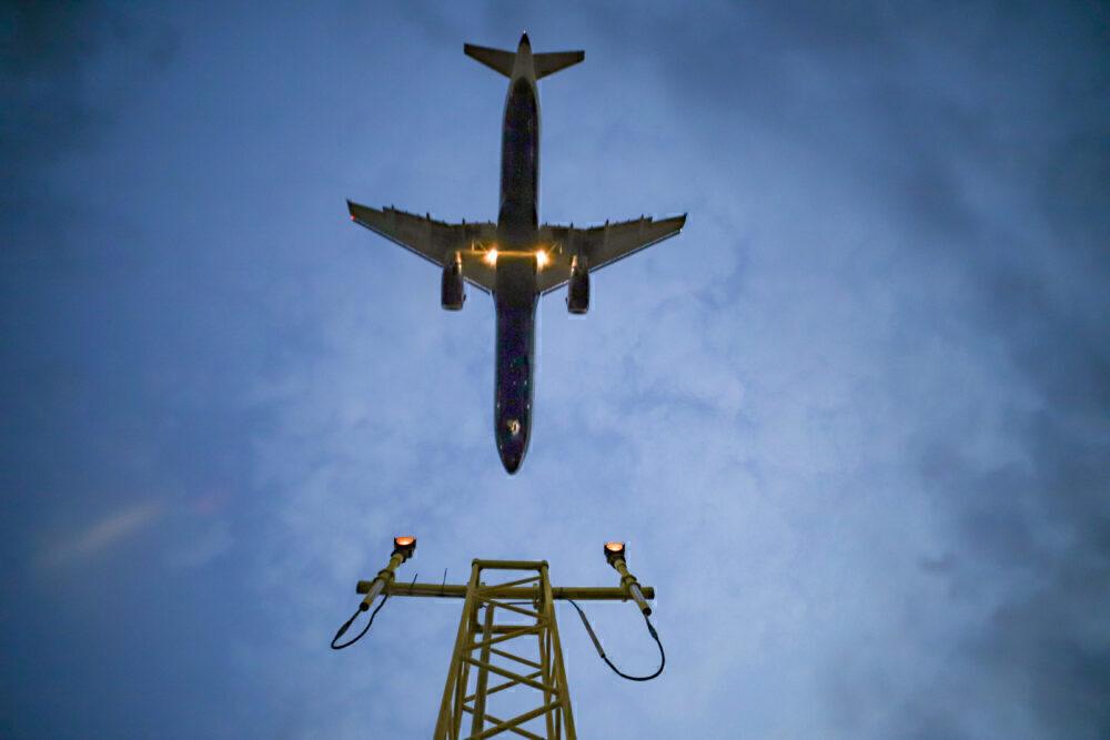 Aircraft landing at dusk Heathrow
