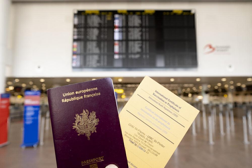Passport next to vaccine certificate