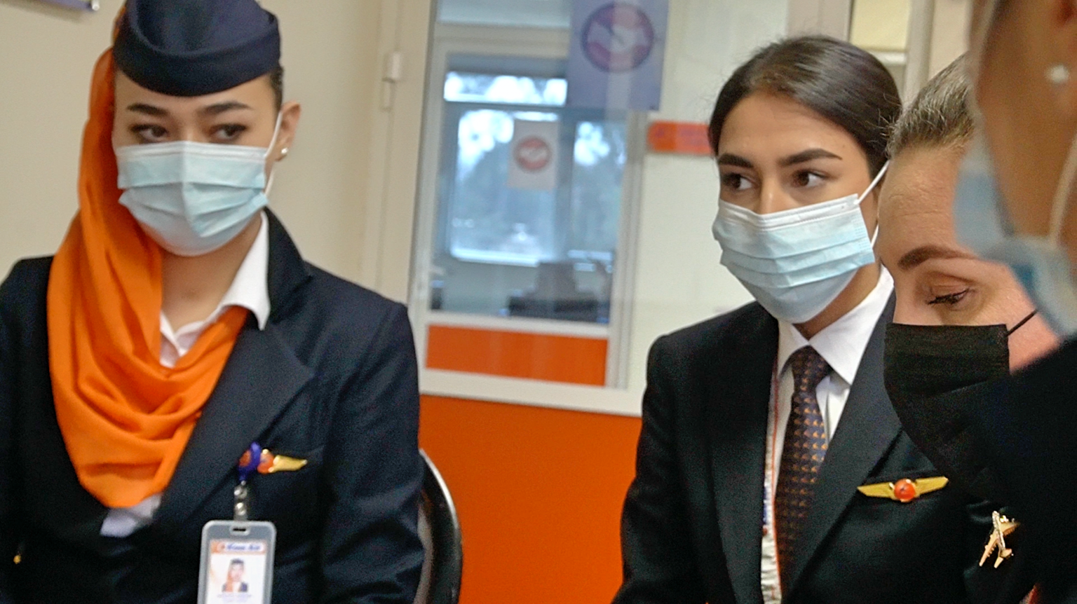 Kam Air all female flight. Female pilots of the flight wearing face masks ready to fly