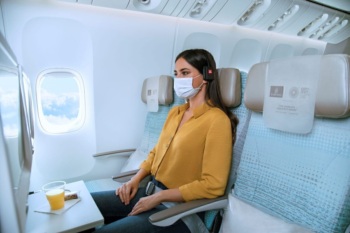 Emirates, Economy, Extra Seat, woman flies with face covering