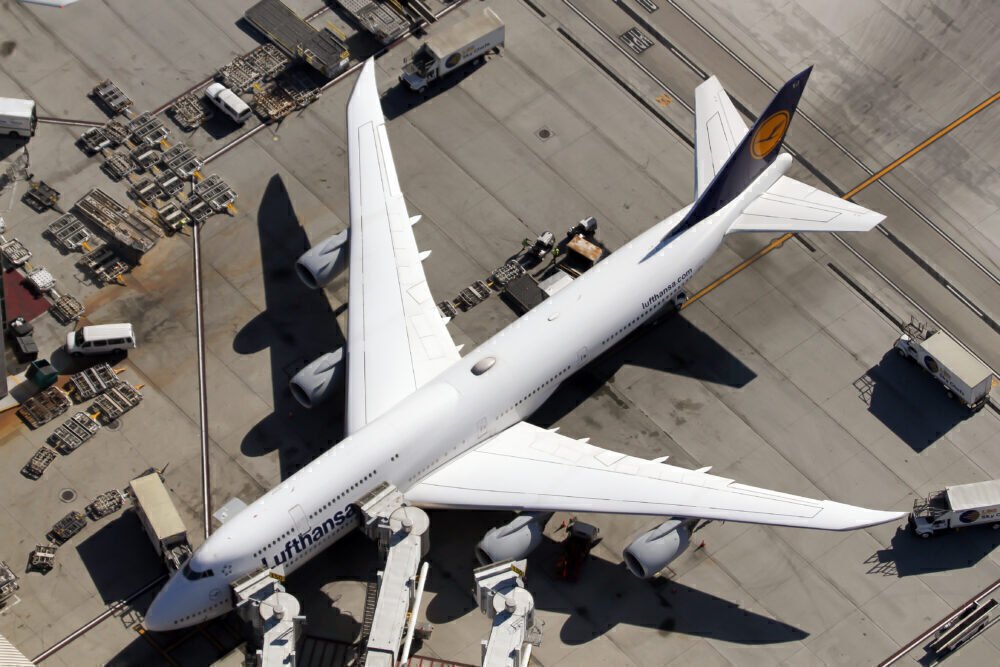 A Lufthansa Boeing 747-800 is seen parked at the stand in